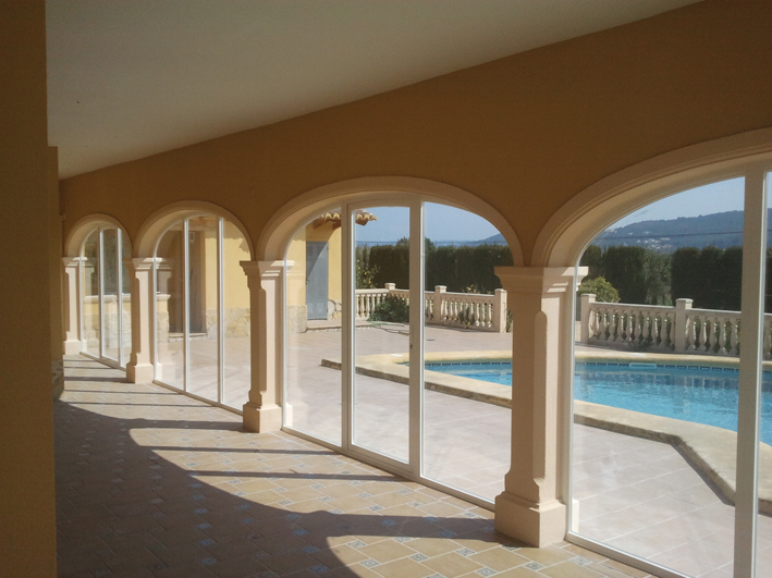 Arched naya enclosures from LUX-AL enhance both the space available and the value of your property